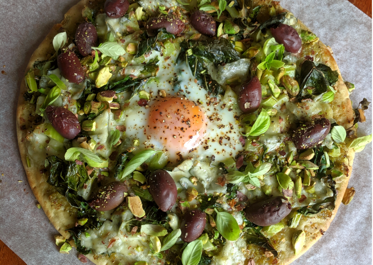 Cauliflower stem and leaf pizza with egg