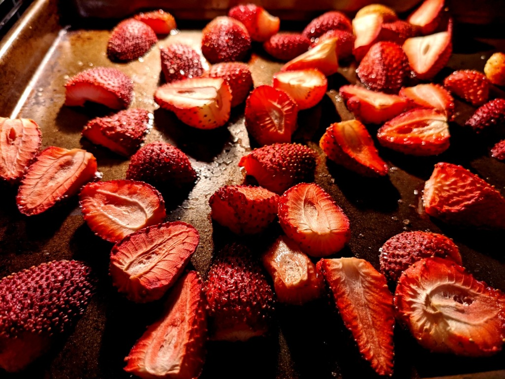 strawberries roasting on an oven tray